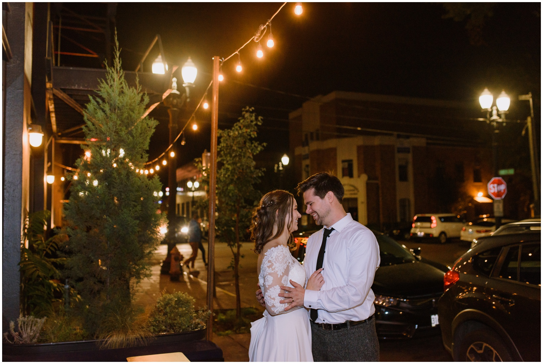A bride and groom looking into each other's eyes at the Evergreen in Portland at night.