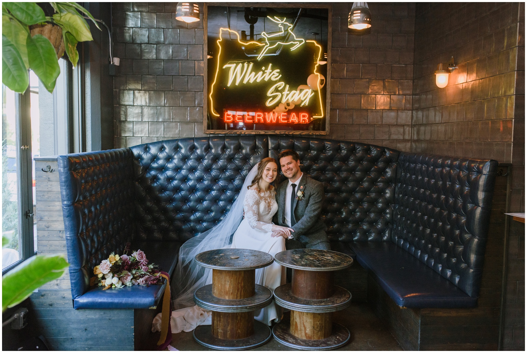 Bride and groom in a booth at the white stag for their wedding at the evergreen in portland