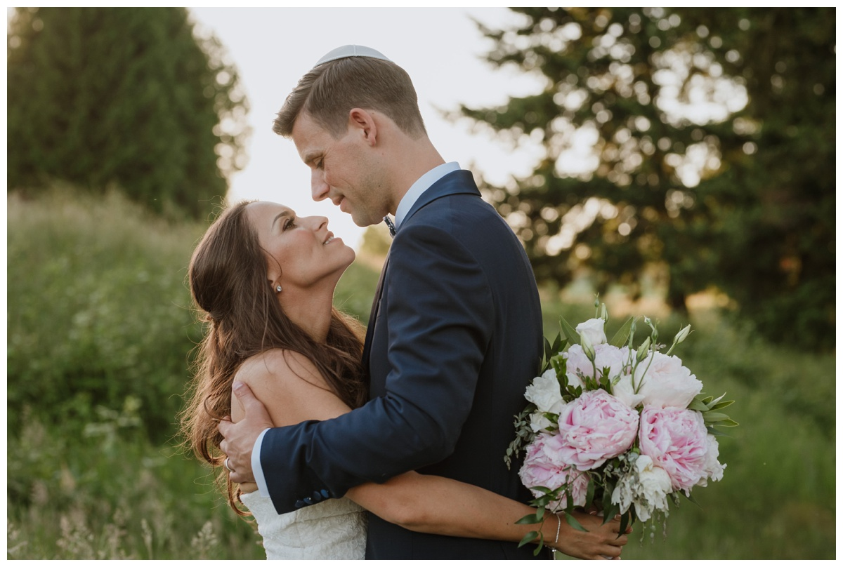 Close up of bride and groom at their oregon golf club wedding